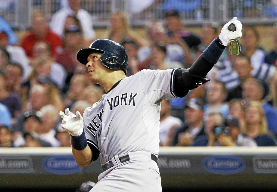 Alex Rodriguez follows through on a solo home run in the ninth inning on Saturday. Photo: Ann Heisenfelt — The Associated Press   / FR13069 AP