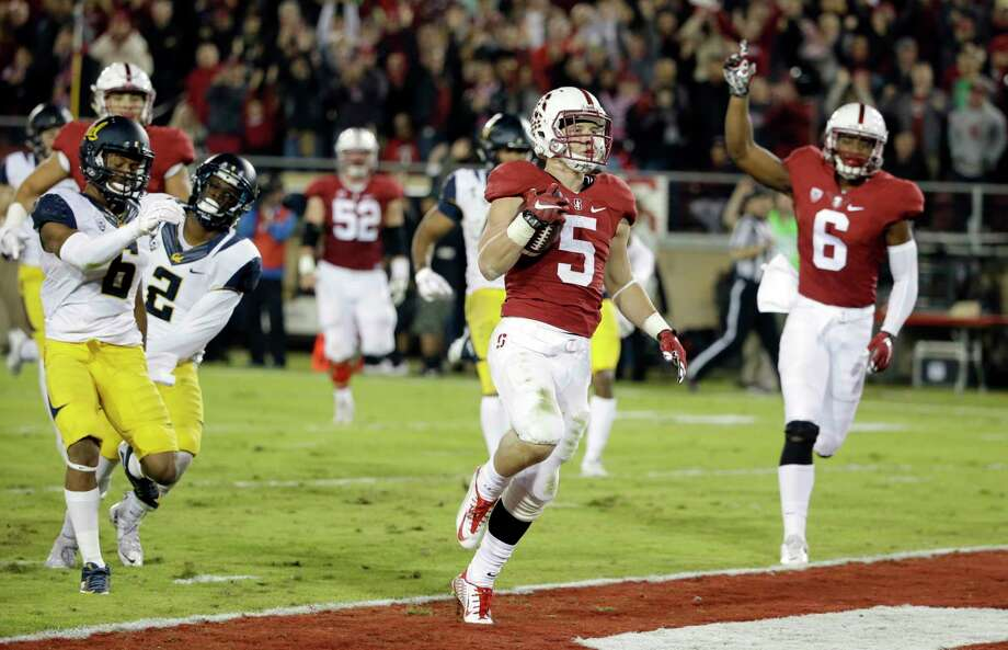 Stanford running back Christian McCaffrey (5) scores a touchdown on a 49-yard catch against California on Saturday. Photo: Marcio Jose Sanchez — The Associated Press   / AP