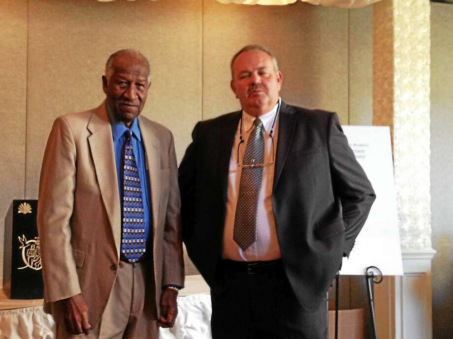 Former Wilbur Cross boys basketball coach Bob Saulsbury, left, was presented with the Polly Sweeten Excellence in Sports Award at Thursday's 8th Annual Farnam Celebrity Sports Breakfast. Standing with Saulsbury is Jim Reynolds, who followed Saulsbury at Cross and is also a member of the Farnam House Board of Directors. Photo: Joe Morelli — Register