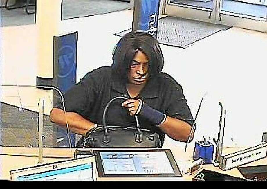 Hamden police are asking for the public's help to find this woman, who allegedly robbed a Webster Bank branch Tuesday morning. Photo: Photo Courtesy Of The Hamden Police Department