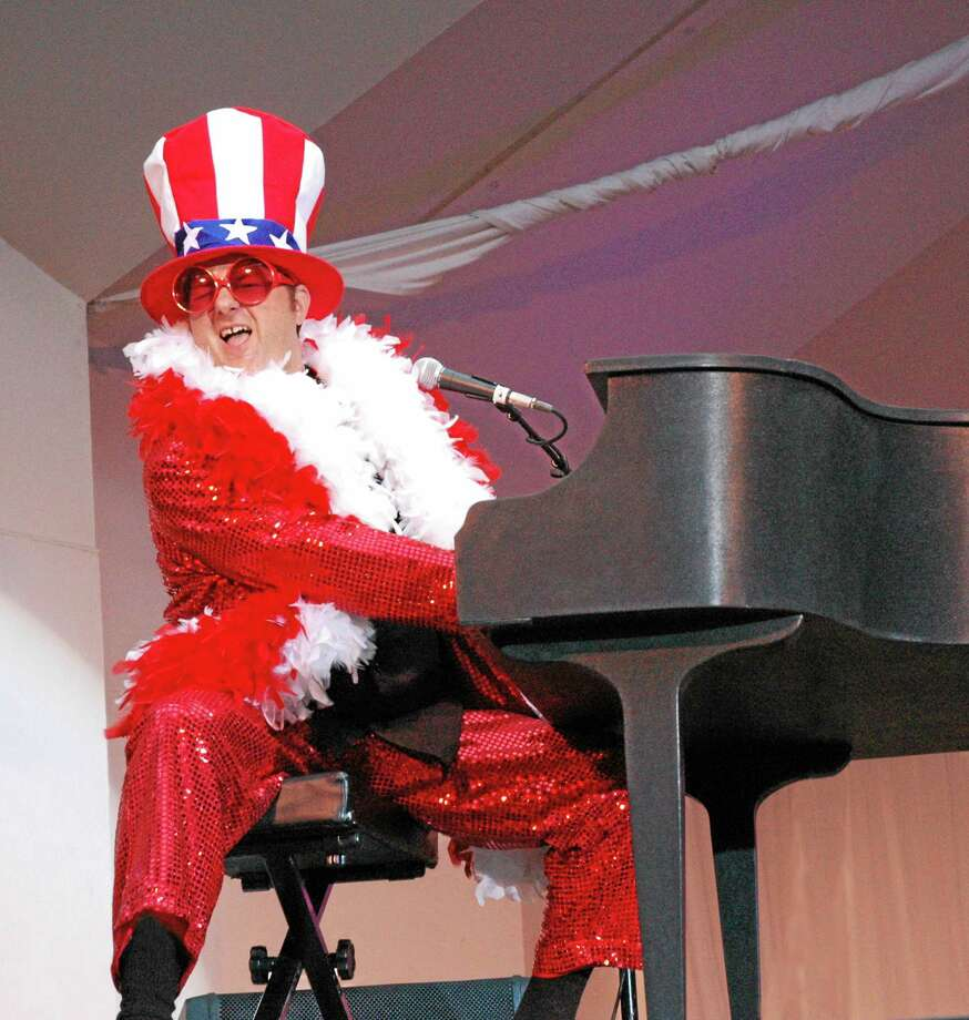 Greg Ransom, who plays Elton John in Bennie and the Jets, gets the party started in Bridgeport New Year's Eve. Photo: Contributed