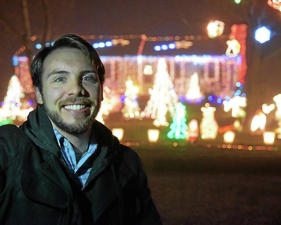 Joe Petrowski Jr. and his bright, colorful Christmas light show at the Petrowski house located at 163 Valley Shores Drive. The light show raises money for the Make-A-Wish-Foundation. Photo: Contributed Photo