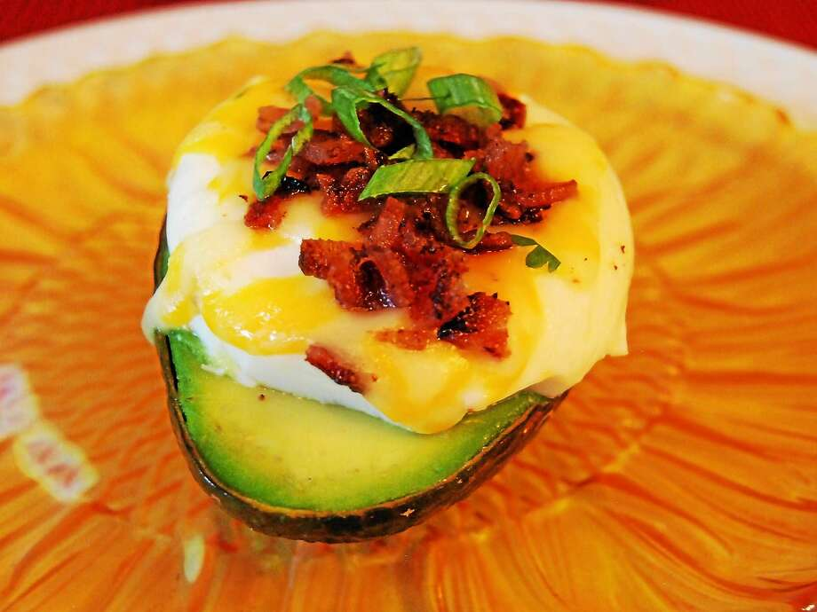 Baked Avocado With Poached Egg, Green Chilies, Colby and Bacon Photo: Robert Rabine