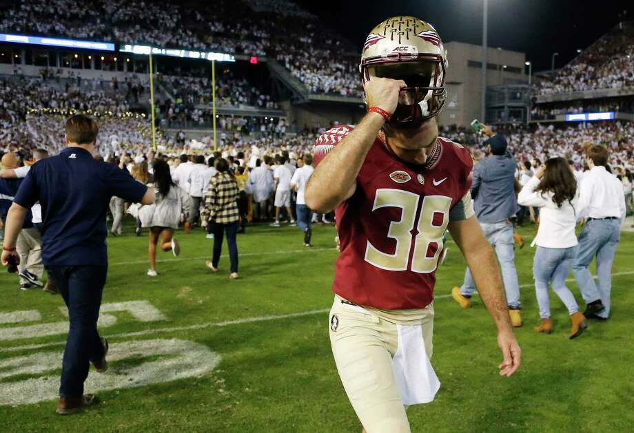 Florida State punter Cason Beatty (38) walks off the field after the Seminoles lost to Georgia Tech on Saturday. Photo: The Associated Press   / AP