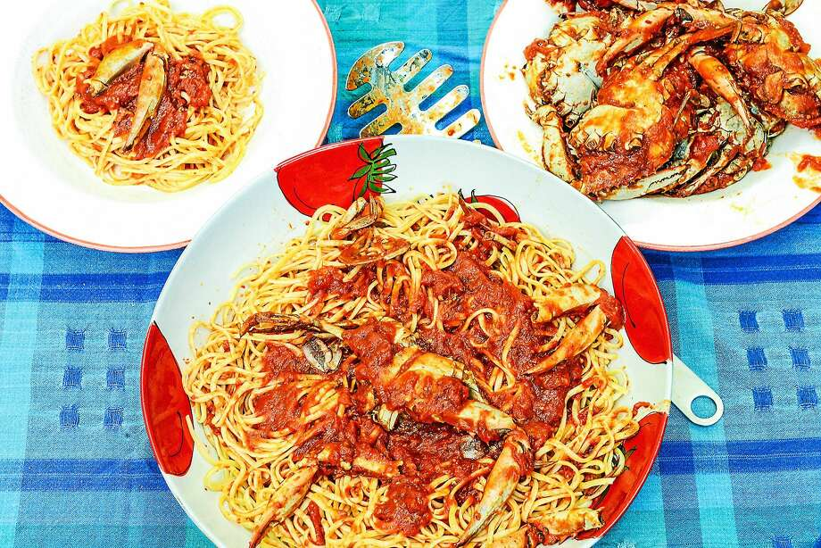 Aunt Phil served her crab sauce over pasta, with plenty of bread for dunking. Photo: Dixie D. Vereen — For The Washington Post   / THE WASHINGTON POST