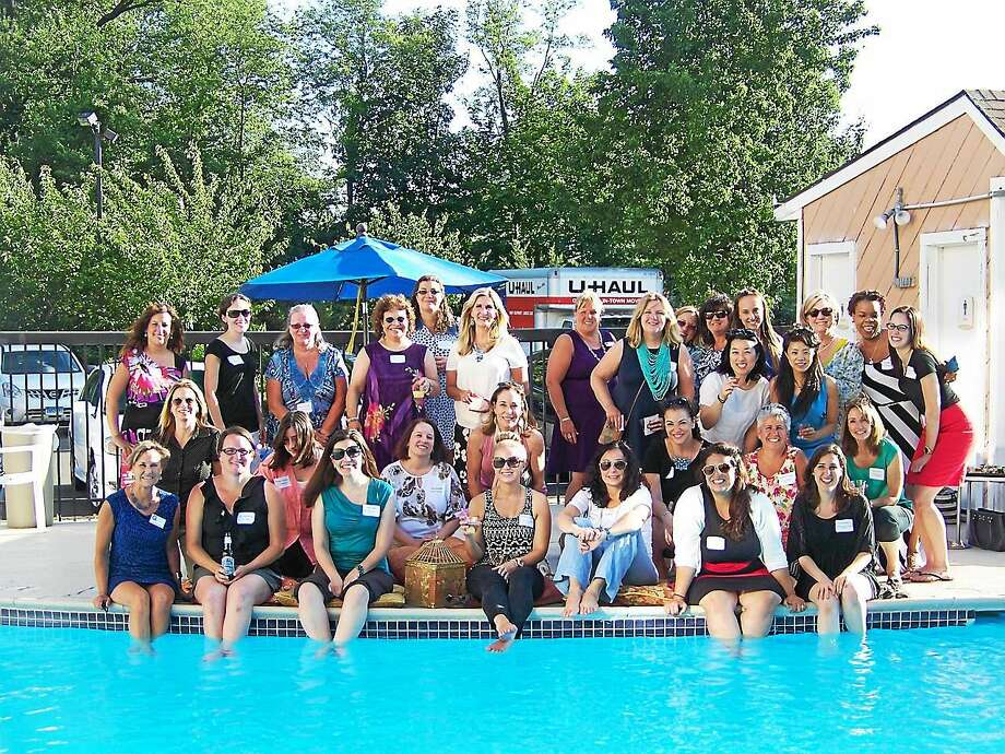 """The Quinnipiac Chamber of Commerce and Greater New Haven Chamber of Commerce held the Women in Networking group's End of the Season Poolside Soiree July 22 at the Fairfield Inn, 100 Miles Drive, Wallingford. Attendees participated in an evening of networking around the pool with hors d'oeuvres sponsored by Bourassa Catering and Events, desserts sponsored by Mozzicato de Pasquale Bakery and Pastry Shop, and cocktails sponsored by The Green Teahouse. The groups' next event will be held in September """"to discuss educational programs, guest speakers, events, and charitable giving for 2015-2016,"""" according to a release. To join the group or for mopre information, call 203-269-9891 or visit www.quinncham.com. Photo: CONTRIBUTED PHOTO"""