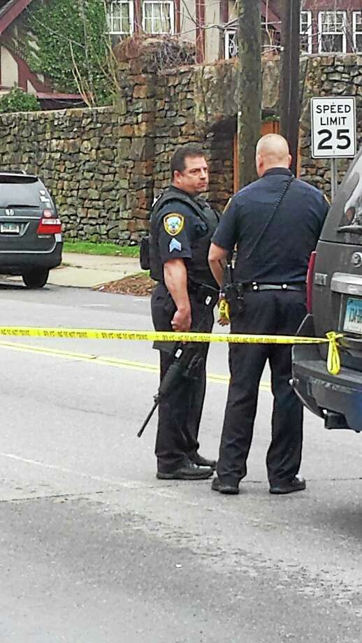 Police at the scene of 636 Main St. where police found a man dead Photo: Contributed Photo