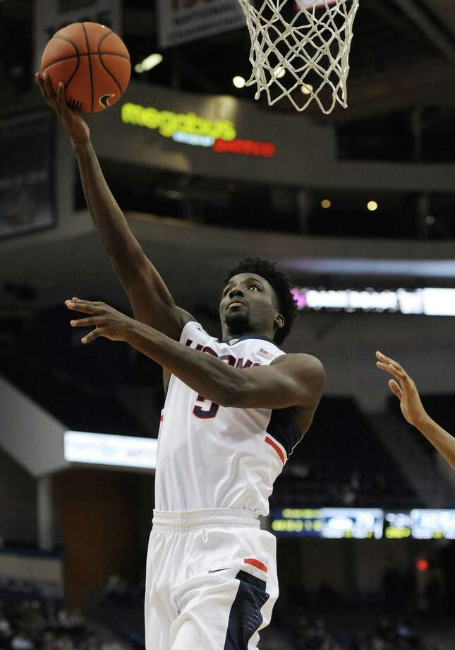 Connecticut's Daniel Hamilton goes up for a basket in the second half of an NCAA college basketball game against Central Connecticut State, Wednesday, Dec. 23, 2015, in Hartford, Conn. UConn won 99-52. (AP Photo/Jessica Hill) Photo: AP / FR125654 AP