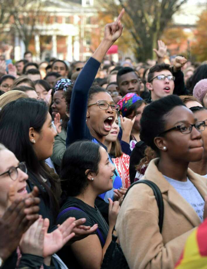 In this Nov. 9, 2015 photo, Yale University students and faculty rally to demand that Yale become more inclusive to all students on Cross Campus in New Haven, Conn. As debates about race and other social issues flare on campuses, college presidents in recent weeks have taken steps to assert the importance of the free expression of ideas. Photo: Arnold Gold/New Haven Register Via AP, File   / New Haven Register