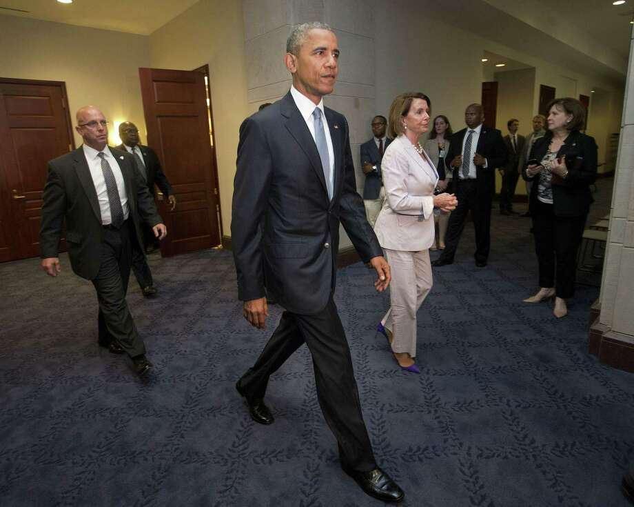 President Barack Obama and House Minority Leader Nancy Pelosi of Calif. leave meeting with House Democrats on Capitol Hill in Washington, Friday, June 12, 2015. The president made an 11th-hour appeal to dubious Democrats on Friday in a tense run-up to a House showdown on legislation to strengthen his hand in global trade talks. Photo: (AP Photo/Pablo Martinez Monsivais) / AP