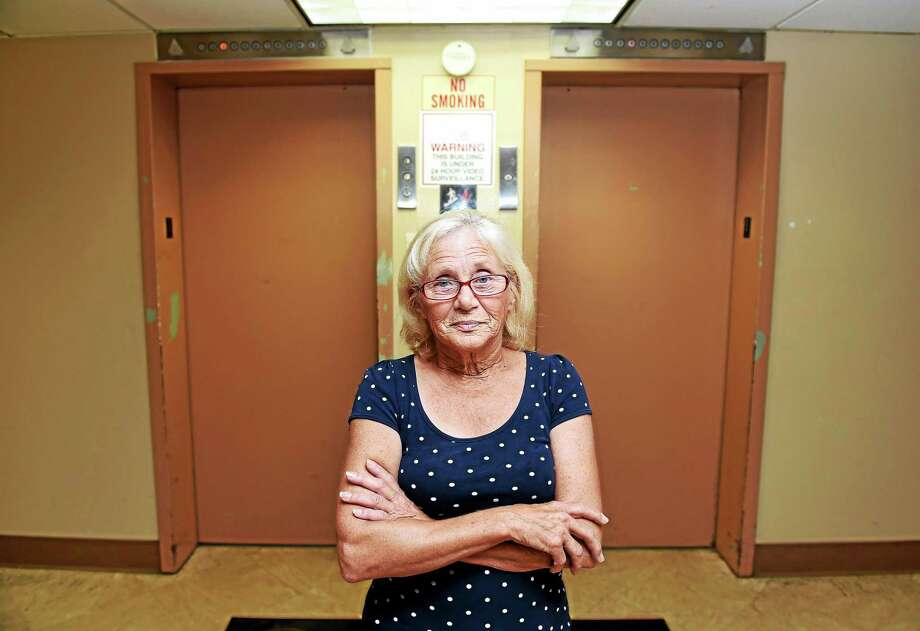 Bea Faulkner, resident of Surfside Senior Housing in West Haven, is photographed in front of the building's elevators on the first floor. Photo: Arnold Gold — New Haven Register