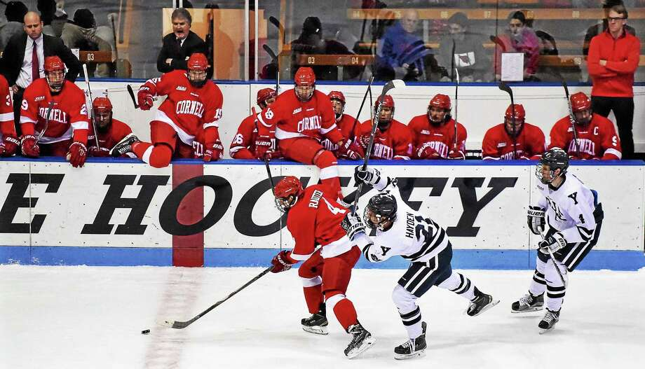Yale right wing John Hayden defends Cornell left wing Alex Rauter battling to a 0-0 tie in overtime at Ingalls Rink in New Haven on Friday, November 20, 2015. (Catherine Avalone/New Haven Register Photo: Journal Register Co. / Catherine Avalone/New Haven Register
