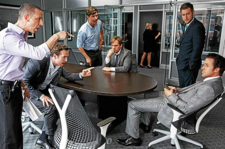 "Jeremy Strong, left, plays Vinnie Daniel, Rafe Spall plays Danny Moses, Hamish Linklater plays Porter Collins, Steve Carell plays Mark Baum, Jeffry Griffin plays Chris and Ryan Gosling plays Jared Vennett in ""The Big Short."" Photo: Jaap Buitendijk — Paramount Pictures   / © 2015 Paramount Pictures.  All Rights Reserved."