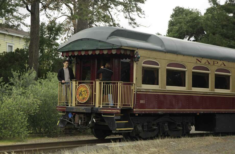 In this June 2, 2011, file photo, a couple takes pictures at the back of the Napa Valley Wine Train as it makes its way through St. Helena, Calif.  Members of a mostly black book club say they believe they were kicked off the train because of their race. The women say they were ordered off the wine train Saturday, Aug. 22, 2015. Book club member Lisa Renee Johnson said that employees told the women they were laughing and talking too loudly. Photo: AP Photo/Eric Risberg, File / AP