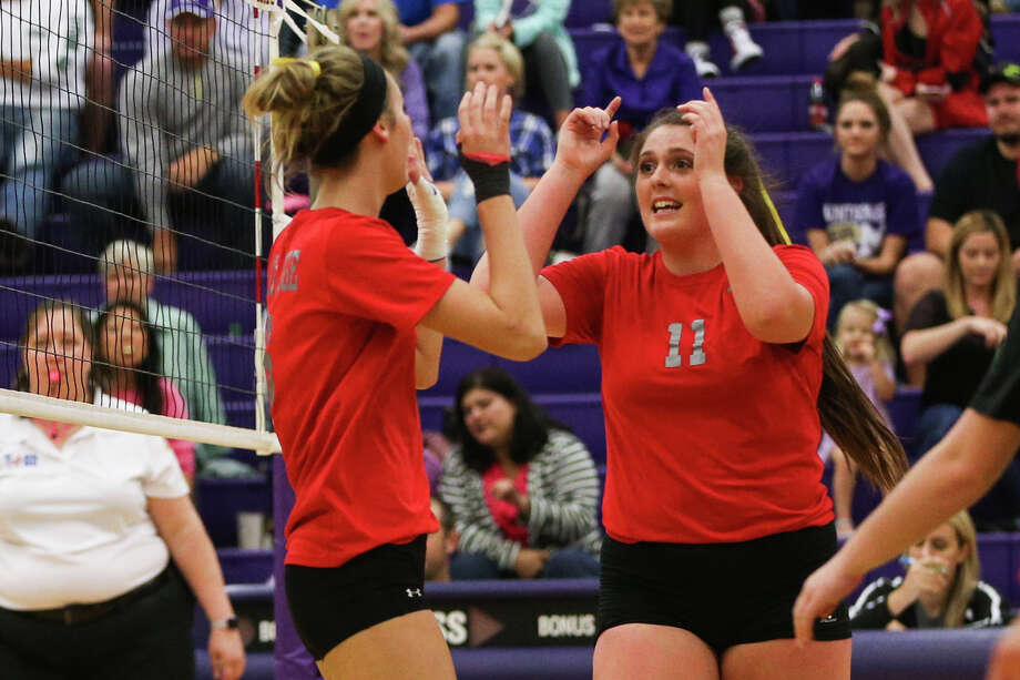Oak Ridge's Carly Graham (11) and Molly Russell (6) celebrate during the varsity volleyball game against Montgomery on Friday, Oct. 21, 2016, at Montgomery High School. (Michael Minasi / Chronicle) Photo: Michael Minasi, Staff / © 2016 Houston Chronicle