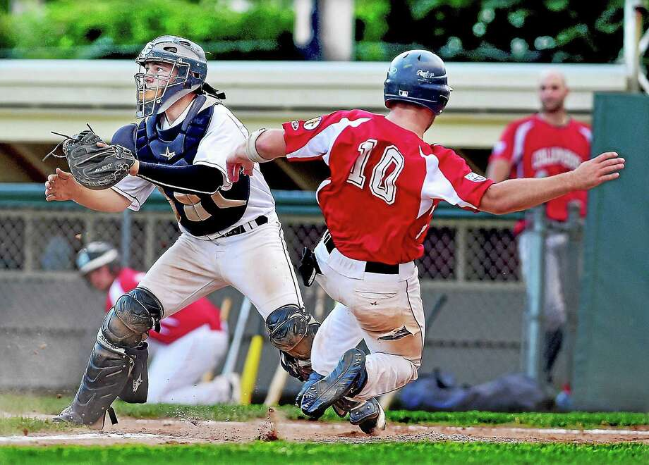 Flanagan Associates catcher Mike DeMartino waits for the throw as Columbus Auto Body's Nick Perrelli slides in safely at home in Friday's game. Photo: Catherine Avalone — Register    / Catherine Avalone/New Haven Register