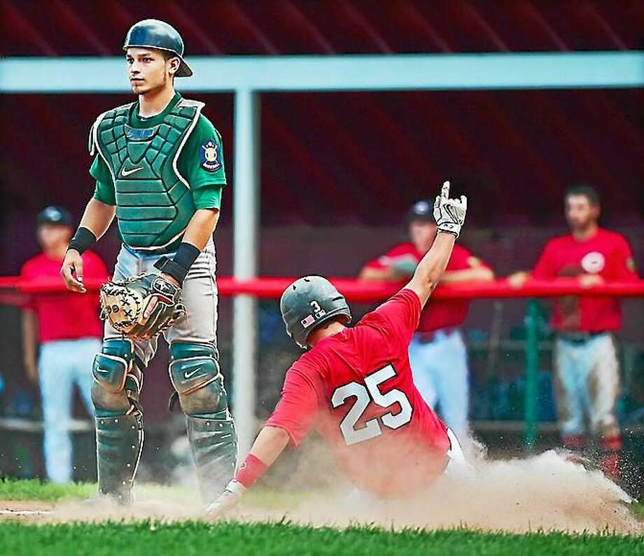 Cheshire's Jason Strollo scores the final run of the game as Hamden catcher Chris Colon looks for the ball during the American Legion playoffs, Thursday afternoon in Cheshire. Cheshire Legion Post 92 won, 3-2, and advances to the Connecticut Senior Tournament. Photo: Catherine Avalone — New Haven Register
