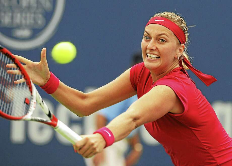 Petra Kvitova, of the Czech Republic, stretches for a backhand during her 6-4, 6-2 victory over Magdalena Rybarikova, of Slovakia, in the final match of the Connecticut Open tennis tournament in New Haven, Conn., on Saturday, Aug. 23, 2014. (AP Photo/Fred Beckham) Photo: AP / FR153656 AP
