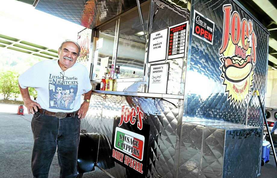 Joe Miani of Derby is photographed with his food cart, Joe's Hot Dog Cafe, next to the train station in Derby on 9/24/2015. Photo: (Arnold Gold — New Haven Register)