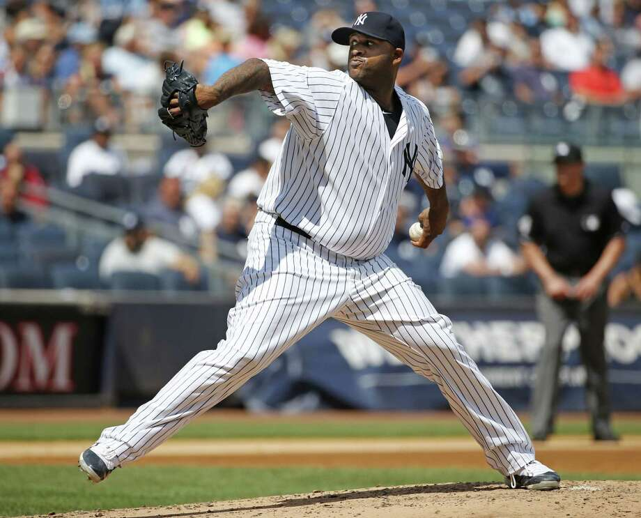 New York Yankees starting pitcher CC Sabathia (52) winds up in a baseball game against the Cleveland Indians at Yankee Stadium in New York, Sunday, Aug. 23, 2015. Sabathia left the game in the third inning (AP Photo/Kathy Willens) Photo: AP / AP