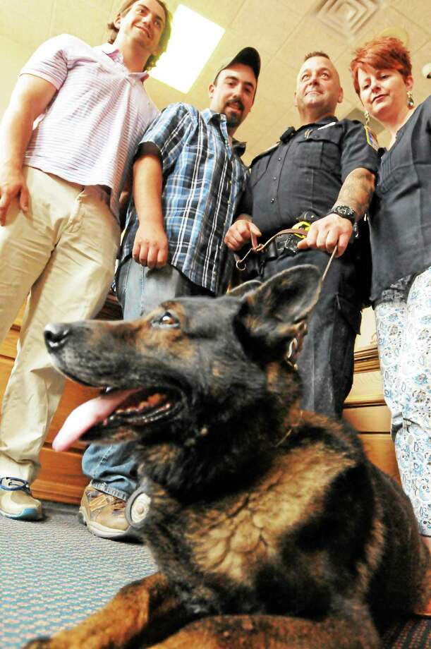 Then retiring Ansonia police dog,  Thor with his family  Ansonia  Police Officer Steven Martins with his sons from left, Hunter and Steven,  and wife Lisa as the Ansonia Police Department honors  K-9 Thor, who is retiring after more than nine years on the force, at a ceremony and reception Monday, June 30, 2014 at the  Ansonia City Hall aldermanic chambers.  Thor has been patrolling city streets with his partner, Officer Steve Martins, since they graduated from the Police Academy in 2005. Photo: (Peter Hvizdak - New Haven Register)   / ©Peter Hvizdak /  New Haven Register