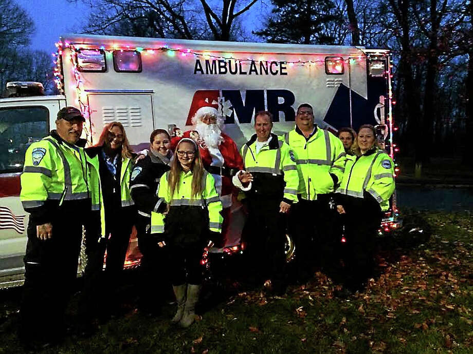 AMR ambulance team stands ready in case of any emergencies. Photo: Courtesy Of Easter Seals Goodwill Industries' Fantasy Of Lights
