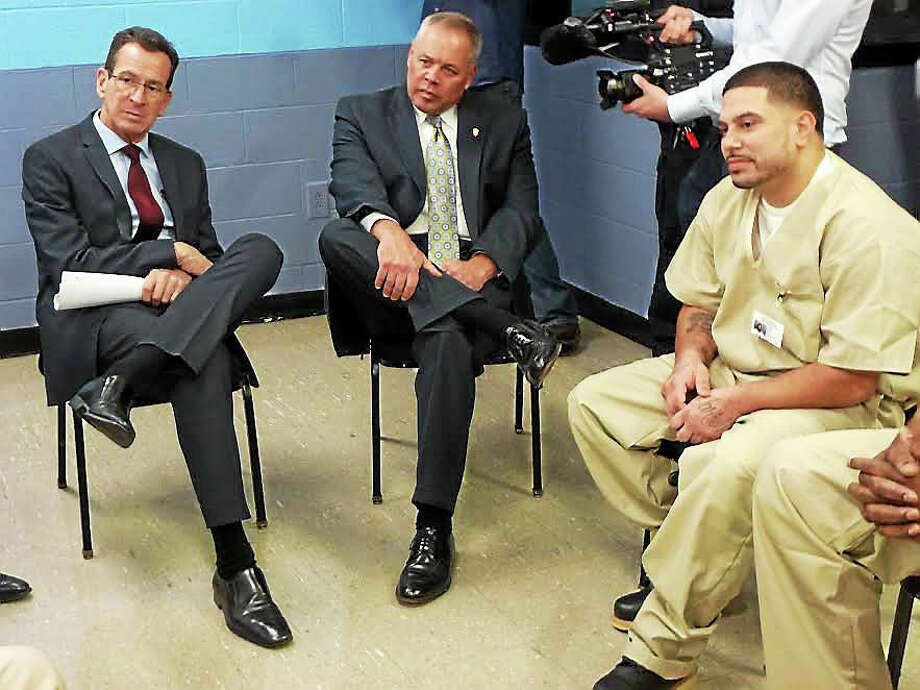 From left, Gov. Dannel P. Malloy, Commissioner Scott Semple and inmate Rafael Santiago discuss difficulties facing convicts who re-enter society. Photo: Ryan Flynn — New Haven Register