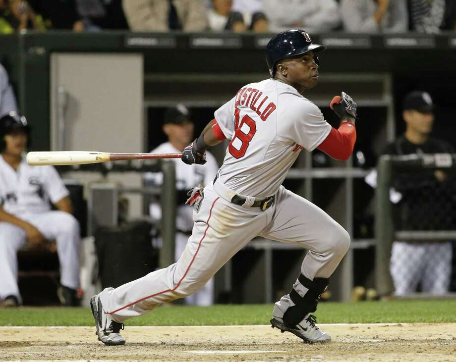 Boston Red Sox's Rusney Castillo watches his two-run double during the fifth inning of a baseball game Monday, Aug. 24, 2015, in Chicago. (AP Photo/Charles Rex Arbogast) Photo: AP / AP