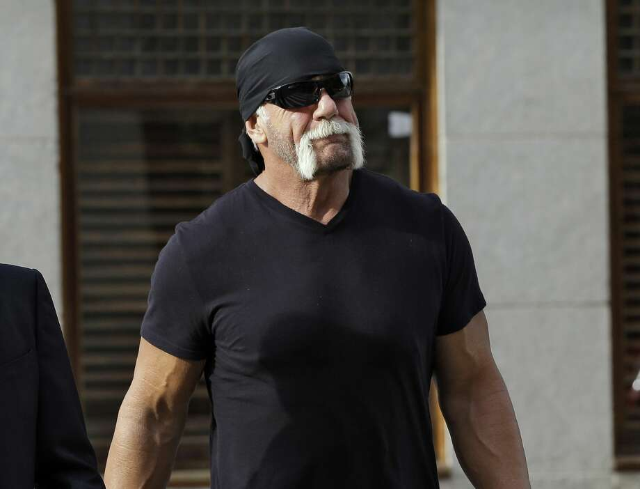 """FILE - In this Oct. 15, 2012 file photo, former professional wrestler Hulk Hogan, whose real name is Terry Bollea, arrives for a news conference at the United States Courthouse in Tampa, Fla. World Wrestling Entertainment Inc. has severed ties with Hogan. The company did not give a reason, but issued a statement Friday, July 24, 2015, saying it is ìcommitted to embracing and celebrating individuals from all backgrounds as demonstrated by the diversity of our employees, performers and fans worldwide."""" Photo: (AP Photo/Chris O'Meara, File) / AP"""