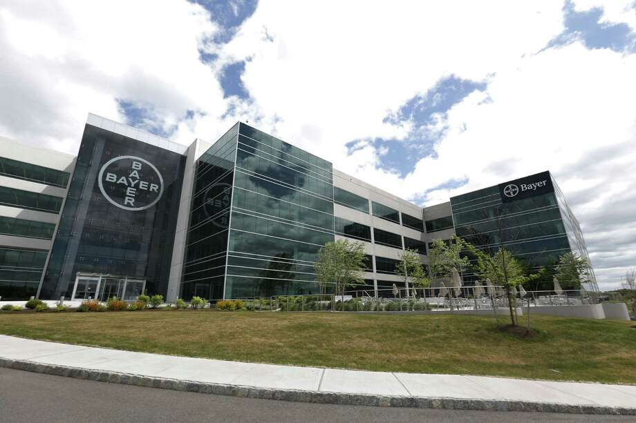 This Wednesday, May 13, 2015, photo shows the North American headquarters of Bayer Healthcare in Whippany, N.J. The Food and Drug Administration on Monday, Sept. 21, 2015 posted a 90-page review of Essure, a Bayer product, online, ahead of a Thursday meeting where experts will re-examine the safety and effectiveness of the implant. Bayer sells the device as an alternative to traditional surgical procedures used to 'tie the tubes,' via incision. (AP Photo/Julio Cortez) Photo: AP / AP