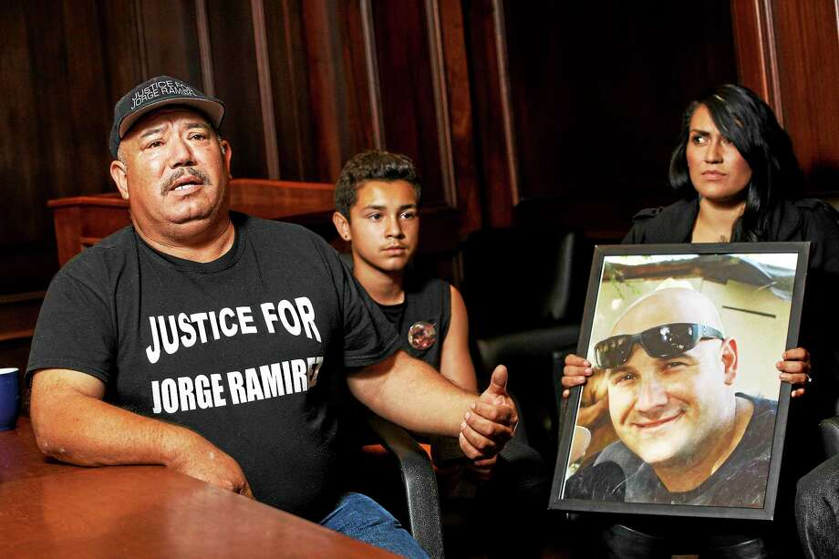 Jorge Ramirez Sr., 58, speaks as Xavier Gonzalez, 13, and Nicole Ramirez, 30, look on in Los Angeles. The three are family members of Jorge Ramirez, an unarmed police informant who was killed by Bakersfield police when a wanted man he was with opened fire on officers. Photo: Patrick T. Fallon For The Washington Post / THE WASHINGTON POST