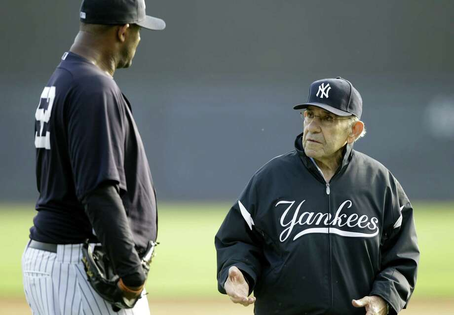 This Feb. 24, 2011 photo shows New York Yankees pitcher CC Sabathia,left, talking with Yogi Berra, right, during a baseball spring training workout at Steinbrenner Field in Tampa, Fla. Berra, the Yankees Hall of Fame catcher has died. He was 90. Photo: AP Photo/Charlie Neibergall, File   / AP