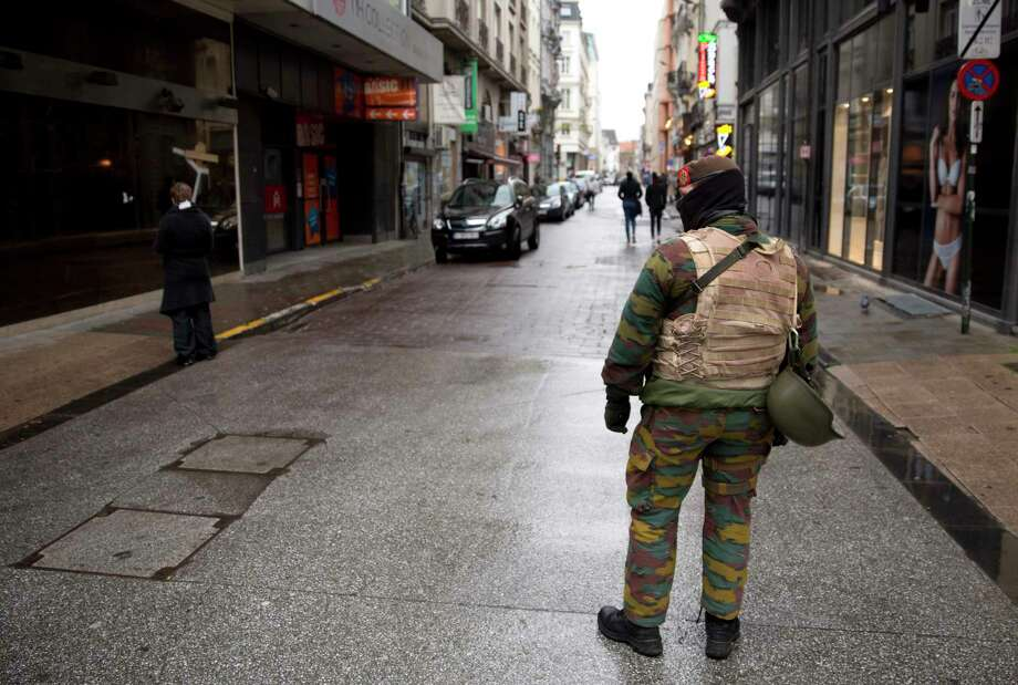 A Belgian Army soldier patrols a main shopping street in Brussels on Saturday, Nov. 21, 2015. Belgium raised its security level to the highest degree on Saturday as the manhunt continues for extremist Salah Abdeslam who took part in the Paris attacks. The security alert shut metros, shops, and cancelled events with high concentrations of people. Photo: AP Photo/Thierry Monasse    / AP