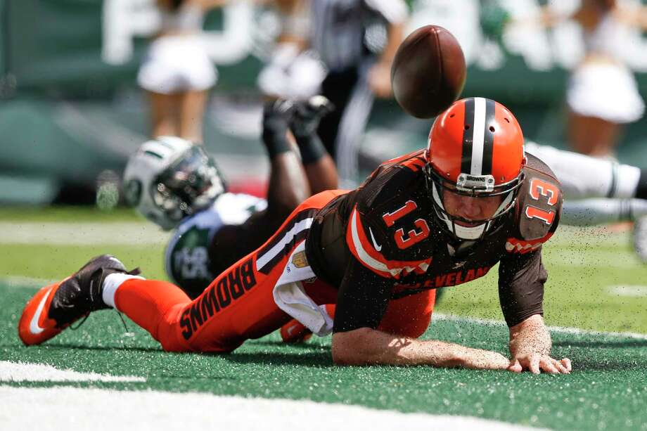 Cleveland Browns quarterback Josh McCown (13) fumbles the ball after being hit near the end zone during a Sept. 13 game against the New York Jets in East Rutherford, N.J. Photo: Kathy Willens — The Associated Press   / AP