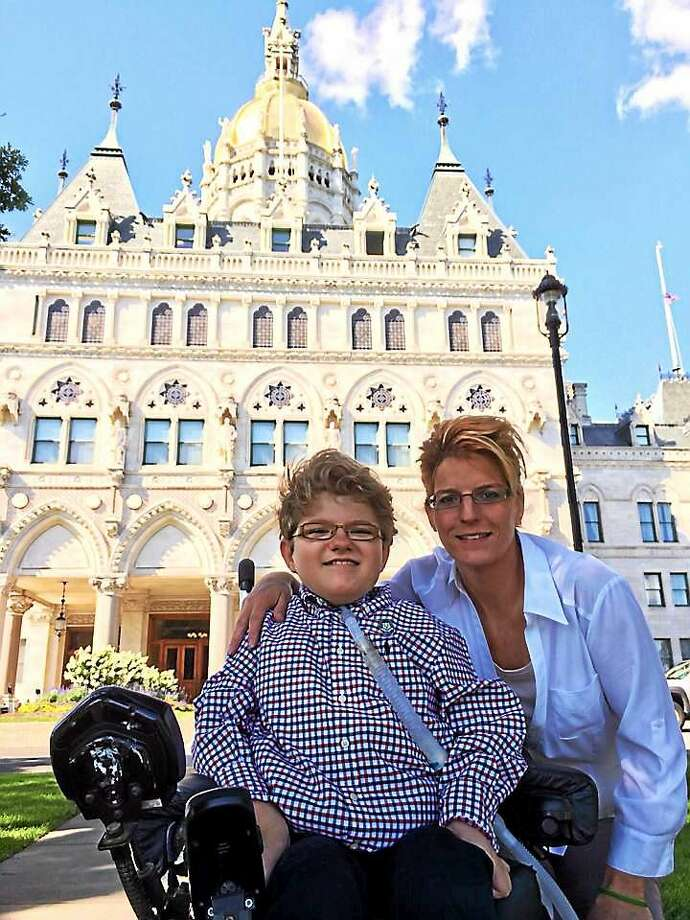 Hunter Pageau in front of the the state Capitol with his mother, Sharon Agli. Photo: Kate Ramunni — New Haven Register