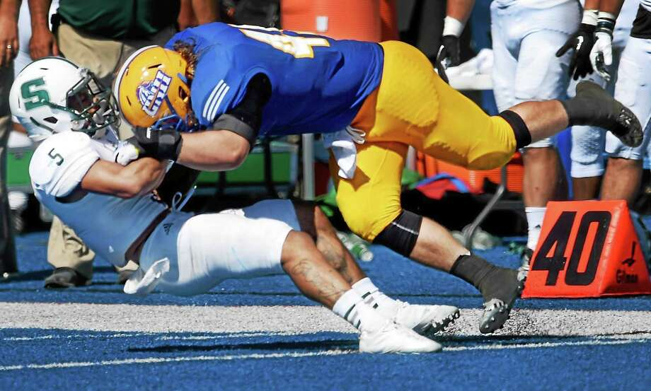 University of New Haven linebacker Tyler Condit tackles Slippery Rock receiver Drew Scales during a game earlier this season. Photo: Peter Hvizdak — Register File Photo   / ©2015 Peter Hvizdak