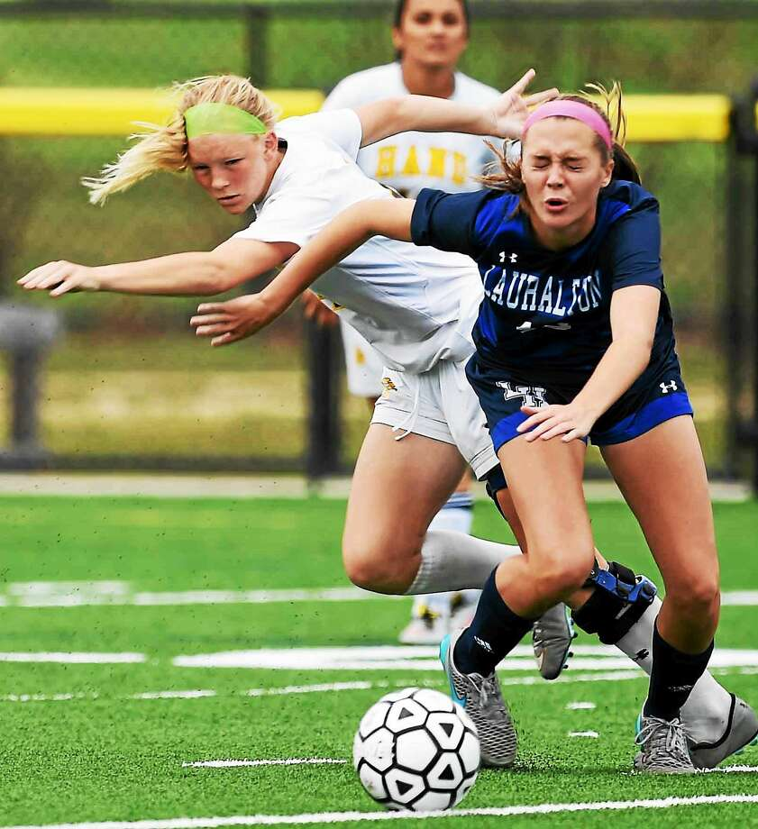 Kelly Derken of Hand and Caroline Monahan of Lauralton Hall chase down a ball during girls soccer first half action Tuesday at the Surf Club in Madison. Hand beat Lauralton Hall 1-0. Photo: Peter Hvizdak -- New Haven Register   / ?2015 Peter Hvizdak