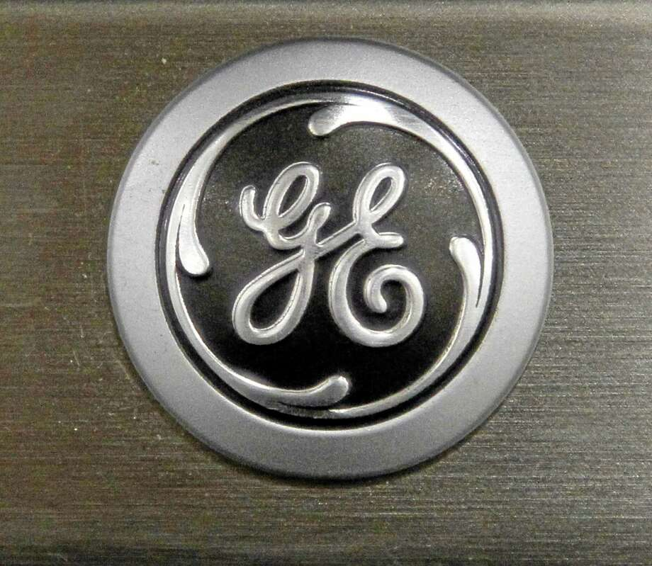 FILE - In this Monday, Sept. 10, 2012 file photo a General Electric logo is seen on a kitchen stove at a Lowe's store in Framingham, Mass.  Industrial companies such as General Electric, Honeywell and Caterpillar, which make expensive equipment that other companies need to buy in order to grow, have been posting strong results in recent weeks and telling investors that orders are strong. Photo: AP Photo/Steven Senne, File / AP