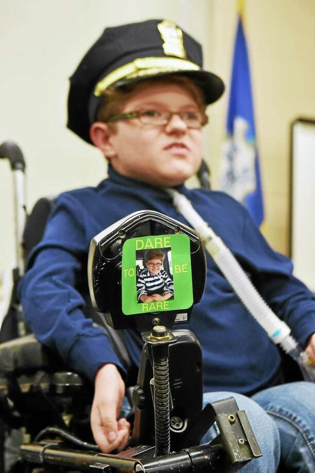 "North Haven 9-year-old Hunter Pagueau addressed members of the North Haven Police Department and Police Commission following a swearing-in ceremony on March 25 at the NHPD. Hunter sported a message on his wheelchair, ""Dare to be rare."" Photo: CATHERINE AVALONE — NEW HAVEN REGISTER FILE PHOTO   / New Haven RegisterThe Middletown Press"