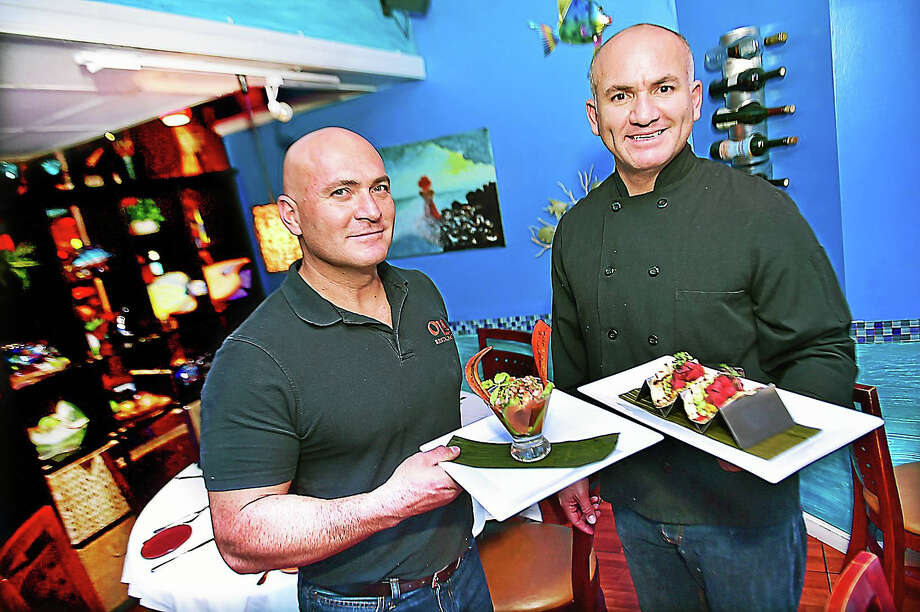 Brothers and co-owners of Ola Restaurant, Wagner Lopez, left, display the Shrimp Ceviche and Melvin Lopez, the Tuna Tacos. Photo: Catherine Avalone — New Haven Register   / New Haven RegisterThe Middletown Press
