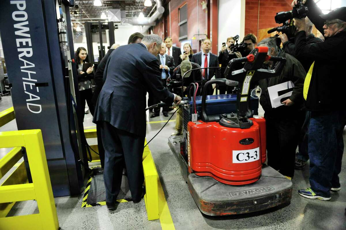 Senator Charles E. Schumer helps to perform the 1 millionth refueling of a GenDrive fuel cell from a GenFuel dispenser at Plug Power during a tour of the company on Monday, Feb. 1, 2016, in Latham, N.Y. (Paul Buckowski / Times Union)