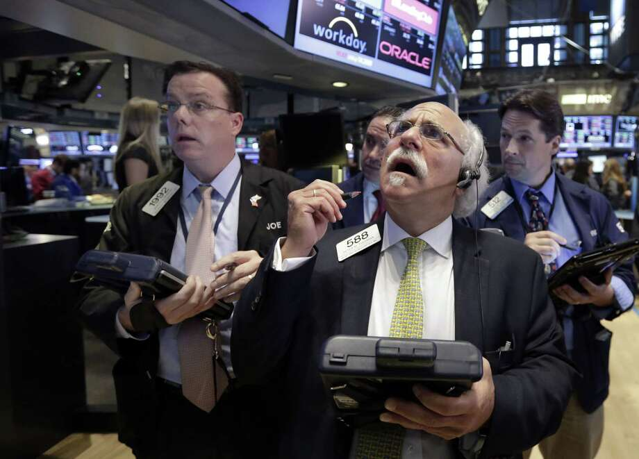 Peter Tuchman, foreground right, works with fellow traders on the floor of the New York Stock Exchange, Monday, Aug. 24, 2015. U.S. stock markets plunged in early trading Monday following a big drop in Chinese stocks. Photo: AP Photo/Richard Drew   / AP