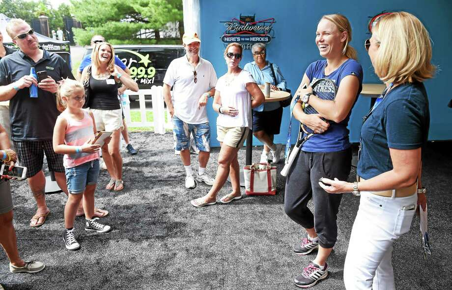 Caroline Wozniacki, second from right, shares a laugh with fans at the Connecticut Open on Saturday. At far right is tournament director Anne Worcester. Photo: Arnold Gold — Register