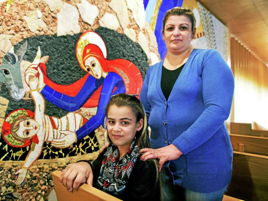 Rajaa and her daughter Katreena, 15, at the Knights of Columbus headquarters chapel in New Haven. Chaldean Catholics from Iraq in danger of persecution from ISIS, they were brought to the United States from Iraq by the Knights of Columbus because Katreena needed medical treatment as she was experiencing kidney failure and a badly infected foot. Katreena was treated by the Connecticut Childrens Medical Center in Hartford. Photo: Peter Hvizdak — New Haven Register   / ©2015 Peter Hvizdak