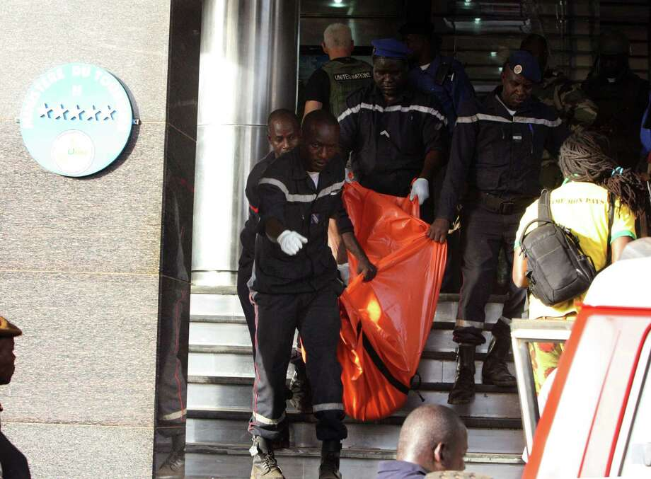 A body is removed from the  Radisson Blu hotel, after it was stormed by gunmen during a attack on the hotel in Bamako, Mali, Friday, Nov. 20, 2015. Islamic extremists armed with guns and grenades stormed the luxury Radisson Blu hotel in Mali's capital Friday morning, and security forces worked to free guests floor by floor. Photo: AP Photo/Harouna Traore    / AP