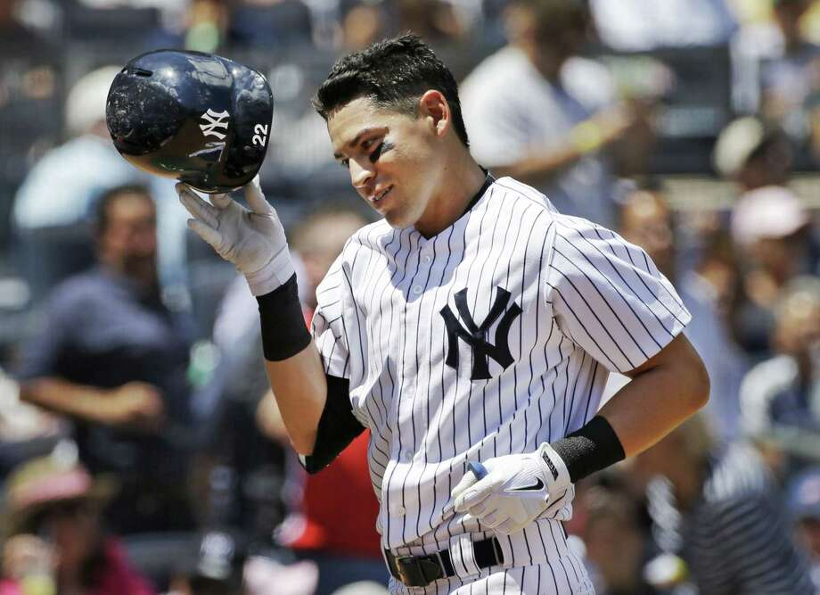 The New York Yankees' Jacoby Ellsbury removes his helmet after crossing the plate on a second-inning home run against the Baltimore Orioles at Yankee Stadium on Thursday. Photo: Kathy Willens — The Associated Press   / AP
