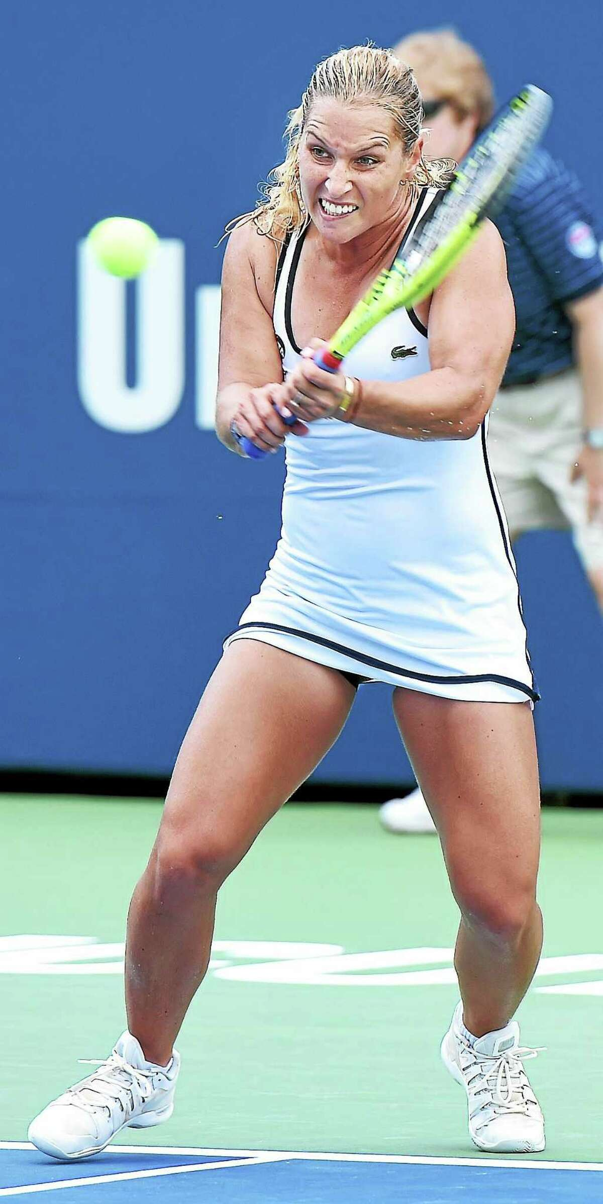 Dominika Cibulkova hits a backhand to Tsvetana Pironkova in the second set of their match at the Connecticut Open on Sunday.