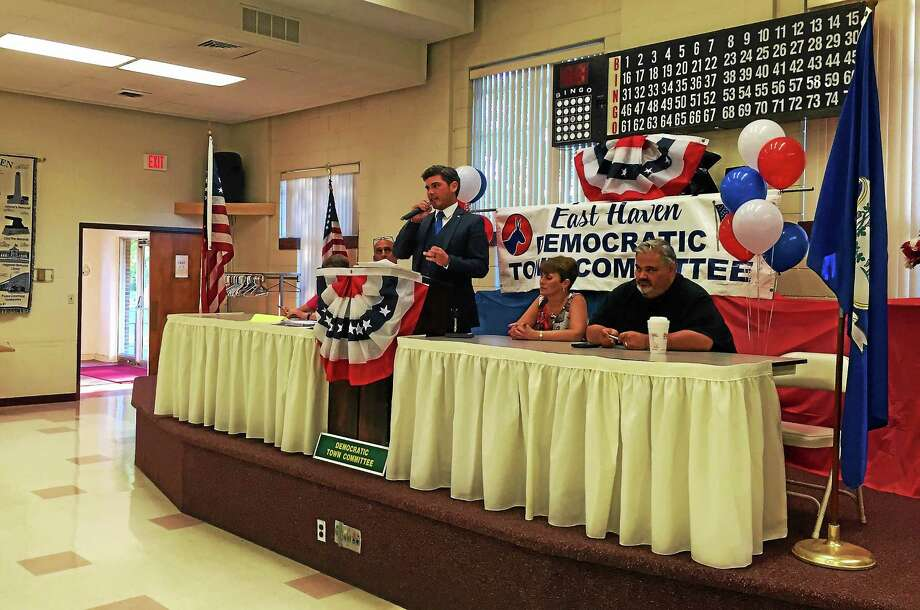 Michael Speer (center) addresses fellow Democrats after being formally nominated as Mayoral candidate on Wednesday in East Haven. Photo: Esteban L. Hernandez--New Haven Register