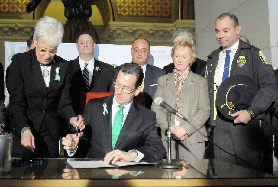 Governor Dannel P. Malloy held a bill signing ceremony for bi-partisan legislation establishing the Sandy Hook Workers Fund at the State Capitol in Hartford. Photo: Photo By Peter Hvizdak--New Haven Register   / ©Peter Hvizdak /  New Haven Register