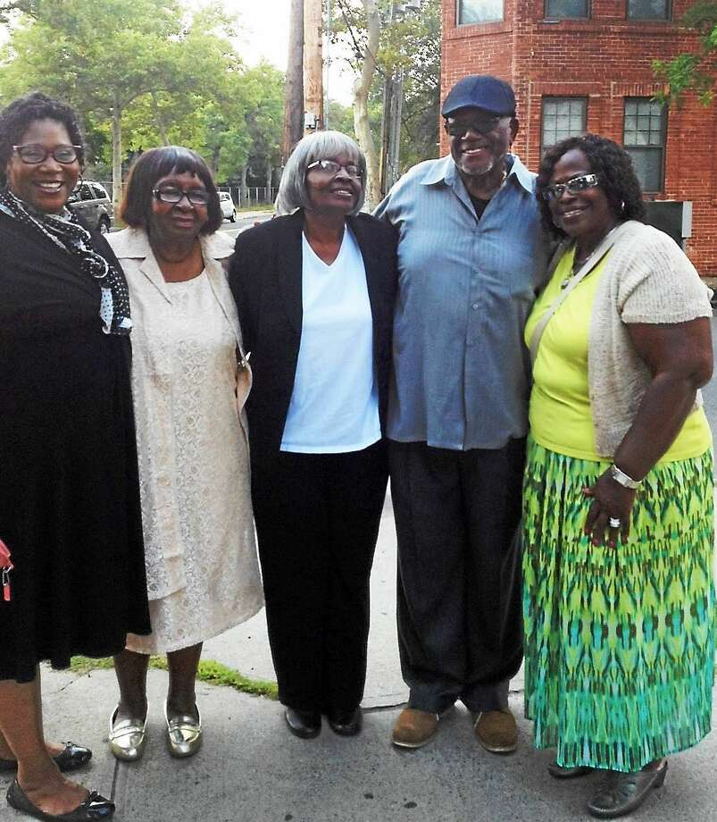 After ceremony dedicating corner of Munson Street and Dixwell Avenue to Bishop Robert J. Gay, he was surrounded by friends. From left, Elder Brenda Ward, Sister Grace Chambers, Mother Ethel T. Gay, Bishop Gay and Mother Delores Ricks. Photo: (Mary O'Leary — New Haven Register)